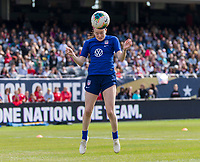 CHICAGO, IL - OCTOBER 5: Rose Lavelle #16 of the United States heads the ball at Soldier Field on October 5, 2019 in Chicago, Illinois.