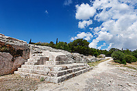 The Pnyx (507 B.C.) with the carved steps of the speaker's platform (bema)  near the Athenian Acropolis, Greece. Pericles, Demosthenes etc. spoke here where democracy was born