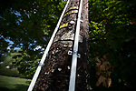 Two white strips of 1-inch conduit pipe, denoting a ritual Jewish Orthodox boundary called an eruv, are attached to a utility pole in Mahwah, N.J., U.S., on Sunday, August 27, 2016. Photographer: Michael Nagle