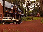 Brick country house or cottage and Volvo XC70 station wagon car in Muskoka, Ontario, Canada countryside scenery. Image © MaximImages, License at https://www.maximimages.com