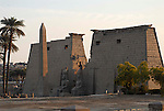 The first Pylon was built by Ramses II who ruled Egypt from 1279-1213 BC. The pink granite obelisk and two 46 foot high colossi of Ramses II stand by the gateway into the temple.The temple was dedicated to the Theban Triad of  Amun,Mut and Khonsu.The town of Luxor occupies the eastern part of a great city of antiquity which the ancient Egytians called Waset and the Greeks named Thebes.