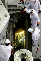 Technicians fetch highly enriched uranium (HEU) assemblies from a water pool under the nuclear reactor at the Institute of Nuclear Physics in Almaty. The removal of Kazakhstan's HEU is part of the U.S. Global Threat Reduction Initiative (GTRI) which tries to secure nuclear material around the world to prevent their misuse.