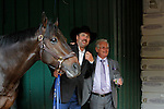May 17, 2014. Second-place finisher Ride On Curlin, his trainer, William Gowan, and winning trainer Art Sherman in the stakes barn after California Chrome's victory in the 139th Preakness Stakes at Pimlico Race Course in Baltimore, MD. ©Joan Fairman Kanes/ESW/CSM