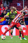 Angel Correa of Atletico de Madrid (front) fights for the ball with Fabio Coentrao of Sporting CP (back)during the UEFA Europa League quarter final leg one match between Atletico Madrid and Sporting CP at Wanda Metropolitano on April 5, 2018 in Madrid, Spain. Photo by Diego Souto / Power Sport Images