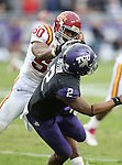 TCU Horned Frogs quarterback Trevone Boykin (2) and Iowa State Cyclones defensive end Willie Scott (50) in action during the game between the Iowa State Cyclones and the TCU Horned Frogs  at the Amon G. Carter Stadium in Fort Worth, Texas. Iowa State defeats TCU 37 to 23...