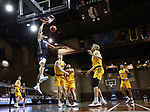 SIOUX FALLS, SD - MARCH 9: Kevin Obanor #0 of the Oral Roberts Golden Eagles dunks past North Dakota State Bison defenders during the 2021 Men's Summit League Basketball Championship at the Sanford Pentagon in Sioux Falls, SD. (Photo by Richard Carlson/Inertia)