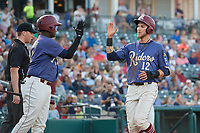 Frisco RoughRiders Charles Leblanc (12) high fives Juremi Profar (13) during a Texas League game against the Springfield Cardinals on May 4, 2019 at Dr Pepper Ballpark in Frisco, Texas.  (Mike Augustin/Four Seam Images)