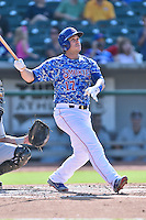 Tennessee Smokies catcher Miguel Montero (17) swings at a pitch during a game against the Birmingham Barons on August 2, 2015 in Kodak, Tennessee. The Smokies defeated the Barons 5-2. (Tony Farlow/Four Seam Images)