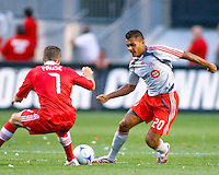 Toronto FC midfielder Amado Guevara (20). tries to pass Chicago midfielder Logan Pause (7).  Chicago Fire defeated Toronto FC by the score of 2-1 at Toyota Park stadium, in Bridgeview, Illinois on Saturday, July 12, 2008.
