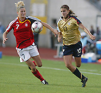 Coquimbo, Chile: American's player Alex Morgan (R) dispute the ball with germany´s player Bianca Schmidt during the semi-final match in the Fifa U-20 Women´s World Cup at Francisco Sanchez Rumoroso stadium in Coquimbo, located at 459 kilometers north of Santiago, on December 4 th, 2008. By Grosnia / ISIphotos.com