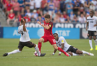 Commerce City, CO - Thursday June 08, 2017: Christian Pulisic, Khaleem Hyland during a 2018 FIFA World Cup Qualifying Final Round match between the men's national teams of the United States (USA) and Trinidad and Tobago (TRI) at Dick's Sporting Goods Park.