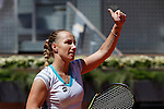 Svetlana Kuznetsova from Russia celebrates her victory at Madrid Open tennis tournament match against Maria Sharapova from Russia in Madrid, Spain. May 08, 2015. (ALTERPHOTOS/Victor Blanco)