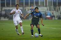 SAN JOSE, CA - SEPTEMBER 13: Oswaldo Alanis #4 of the San Jose Earthquakes dribbles the ball past Ethan Zubak #29 of the L.A. Galaxy during a game between Los Angeles Galaxy and San Jose Earthquakes at Earthquakes Stadium on September 13, 2020 in San Jose, California.