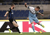 Calcio, Serie A: SS Lazio vs Internazionale Milano, Olympic stadium, Rome, October 29, 2018.<br /> Lazio's Milinkovic Savic (r) in action with Inter's Marcelo Brozovic (l) during the Italian Serie A football match between SS Lazio and Inter Milan at Rome's Olympic stadium, on October 29, 2018.<br /> UPDATE IMAGES PRESS/Isabella Bonotto