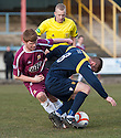 Alloa's Ryan McCord and Albion's Conor Stevenson challenge for the ball under the nose of referee Gary Hilland.