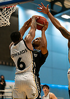 Cortez Edwards of Newcastle Eagles blocks Lacey James of Surrey Scorchers during the BBL Championship match between Surrey Scorchers and Newcastle Eagles at Surrey Sports Park, Guildford, England on 20 March 2021. Photo by Liam McAvoy.