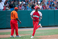 15 February 2009: Second base Hector Olivera of the Orientales runs the bases during a training game of Cuba Baseball Team for the World Baseball Classic 2009. The national team is pitted against itself, divided in two teams called the Occidentales and the Orientales. The Orientales win 12-8, at the Latinoamericano stadium, in la Habana, Cuba.