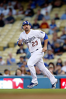 Adrian Gonzalez #23 of the Los Angeles Dodgers runs the bases during a game against the Colorado Rockies at Dodger Stadium on September 29, 2012 in Los Angeles, California. Los Angeles defeated Colorado 3-0. (Larry Goren/Four Seam Images)