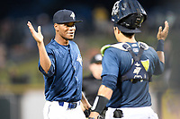 Closing pitcher Jose Moreno (26) of the Columbia Fireflies greets catcher Juan Uriarte after securing the final strikeout and earning the save in a 3-2 win over the Augusta GreenJackets on Saturday, June 1, 2019, at Segra Park in Columbia, South Carolina. (Tom Priddy/Four Seam Images)