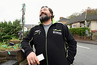 Pictured: Jerry Adams, the new owner of the Allosaurus dinosaur in Cwmbran, Wales, UK.<br /> Re: A 15ft tall Allosaurus has become a star attraction since it arrived at the front garden of a house in Cwmbran, south Wales, with hundreds of people already stopping to get a glimpse.<br /> It was auctioned off by Dan-yr-Ogof , The National Showcaves Centre for Wales for charity and Jerry Adams was the highest bidder with an offer of £1600.<br /> Motorists couldn't believe what they were seeing when they passed the dinosaur, complete with number plate on its tail, as it was towed on a trailer around 50 miles along the M4 from the Abercrave attraction on the outskirts of Swansea to its new home.<br /> Now people are contacting the showcaves on Facebook to find out exactly where it is so they can take their kids to see the creature, which measures 30ft in length.<br /> Jerry Adams pictured.