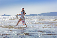 Natasha Jenkins enjoys the sunshine by the beach in what is believed to be one of the warmest days in September this year, in Swansea Bay, Wales, UK. Saturday 14 September 2019