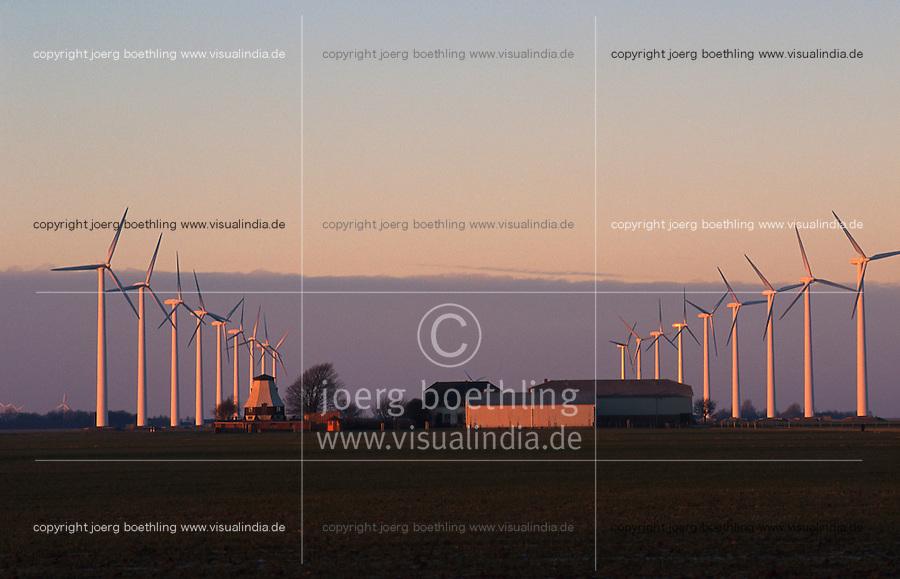 DEUTSCHLAND Windkraftanlagen NEG Micon und alte Windmuehle im Abendlicht in Schleswig Holstein, Windpark Westküste Kaiser Wilhelm Koog / GERMANY windfarm with new wind turbine NEG Micon and old windmill in Northern Germany