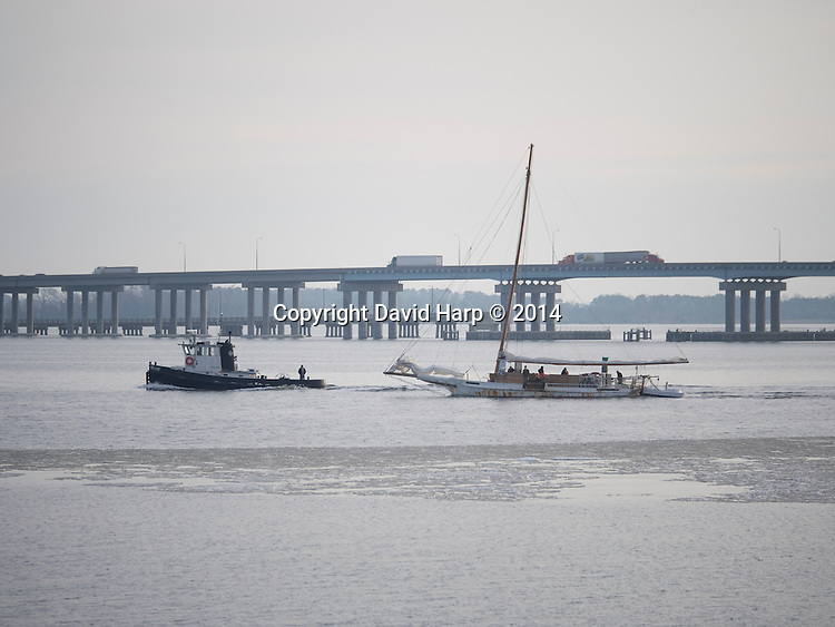 The Maryland state boat Big Lou, which  is sometimes pressed into service as an icebreaker, cuts a path through thin ice off Cambridge Creek so Captain Murphy and his crew can oyster down the river.