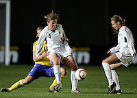 Maria Aronsson (L) holds Cat Whitehill (R) at the VRS Antonio Stadium in VRS Antonio, March 12 of 2007, during the Algarve Women´s Cup soccer match between USA and Sweden. USA won 3-2.