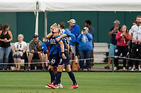 TACOMA, WA - JULY 31: Eugenie Le Sommer #9 of the OL Reign and her teammates celebrate her goal during a game between Racing Louisville FC and OL Reign at Cheney Stadium on July 31, 2021 in Tacoma, Washington.