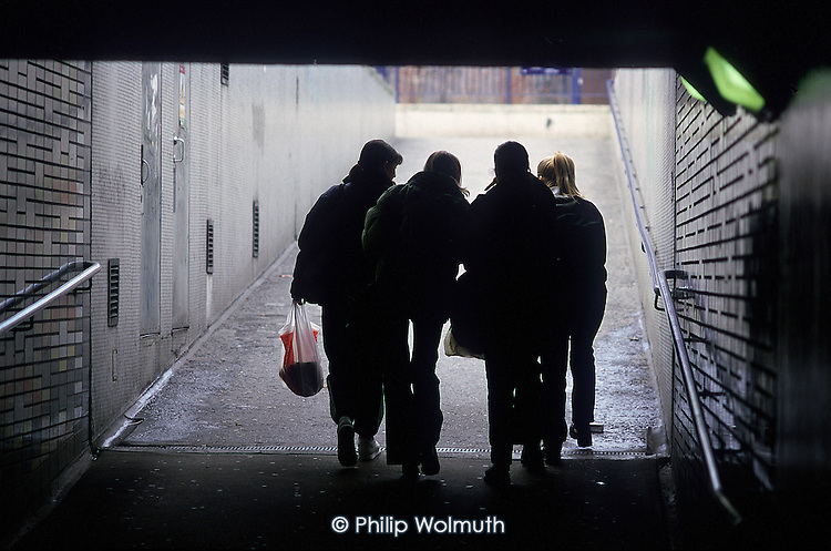 Teenagers walking through an underpass, Elephant and Castle, London.
