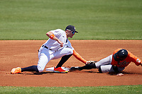 Detroit Tigers shortstop Trei Cruz (71) tags Hudson Haskin (9) out while sliding into second base on a stolen base attempt during a Minor League Spring Training game against the Baltimore Orioles on April 14, 2021 at TigerTown in Lakeland, Florida.  (Mike Janes/Four Seam Images)