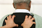 A carer receives a massage during a Carers Day organised by Haringey Council in north London.