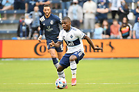 KANSAS CITY, KS - MAY 16: Deiber Caicedo#7 Vancouver Whitecaps with the bal during a game between Vancouver Whitecaps and Sporting Kansas City at Children's Mercy Park on May 16, 2021 in Kansas City, Kansas.