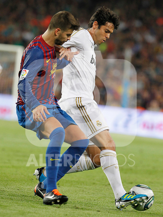FC Barcelona's Gerard Pique (l) and Real Madrid's Kaka during Spanish Supercup 2nd match.August 17,2011. (ALTERPHOTOS/Acero)