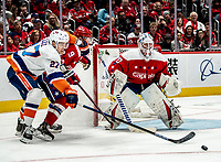 WASHINGTON, DC - JANUARY 31: Dmitry Orlov #9 of the Washington Capitals and Anders Lee #27 of the New York Islanders battle for the puck in front of the Caps goal during a game between New York Islanders and Washington Capitals at Capital One Arena on January 31, 2020 in Washington, DC.