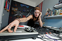 Race Imboden, 19, spins the vinyl in his Park Slope, Brooklyn apartment in NY on Sunday, July 15, 2012.  Imboden, the youngest member of the 2012 U.S. Olympic team for the men's foil event, is also an amateur DJ.