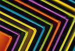 Colorful boxes laid out and evenly spaced creating a colorful pattern.