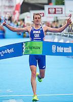 24 JUN 2012 - KITZBUEHEL, AUT - Alistair Brownlee (GBR) of Great Britain wins the men's 2012 World Triathlon Series round in Schwarzsee, Kitzbuehel, Austria (PHOTO (C) 2012 NIGEL FARROW)