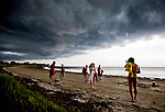 After a day of sunshine, beach visitors pack up as a storm approaches Shell Point Beach in Wakulla County Florida south of Tallahassee.
