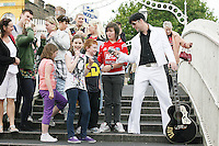 """NO REPRO FEE. 11/8/2010. Elvis Presley Story. Irelands foremost Elvis performer Kevin Doyle is pictured in his Elvis costume rehearsing on the Ha Penny Bridge Dublin in preparation for his show """" Kevin Doyle Sings the Elvis Presley Story"""" this Sunday the 15th of August at the Olympia Theatre. Tickets are from 25.50 including booking fee on sale now. Picture James Horan/Collins Photos"""