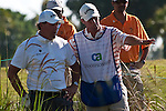 DORAL, FL. - Phil Mickelson and his caddie chat after his shot went  out of bounds during final round play at the 2009 World Golf Championships CA Championship at Doral Golf Resort and Spa in Doral, FL. on March 15, 2009