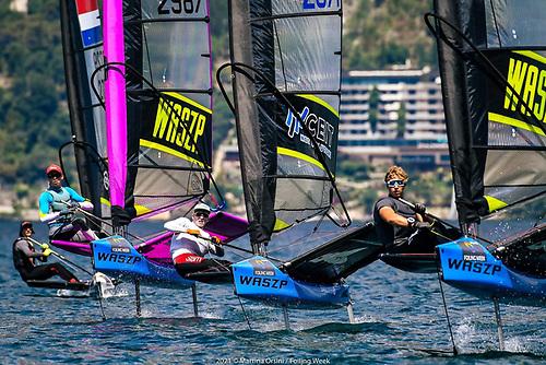 Charlie Cullen of the RstGYC IRL 2987 (Purple Mast) on Fraglia VelaMalcesine, on Lake Garda