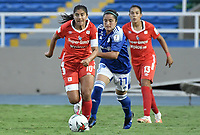 CALI - COLOMBIA, 07-12-2020: Catalina Usme del América y Lisseth Moreno de Millonarios durante el partido entre América de Cali y Millonarios F.C. por la semifinal vuelta como parte de la Liga Femenina BetPlay DIMAYOR 2020 jugado en el estadio Pascual Guerrero de la ciudad de Cali. / Catalina Usme of America and Lisseth Moreno of Millonarios during second leg semifinal match as part of Women's BetPlay DIMAYOR 2020 League between America de Cali and Millonarios F.C. played at Pascual Guerrero stadium in Cali. Photo: VizzorImage / Gabriel Aponte / Staff