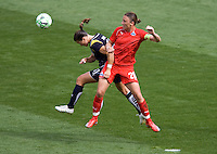 LA Sol's Brittney Bock and Washington Freedom's Abby Wambach do battle. The LA Sol defeated the Washington Freedom 2-0 in the opening game of Womens Professional Soccer at Home Depot Center stadium on Sunday March 29, 2009.  .Photo by Michael Janosz