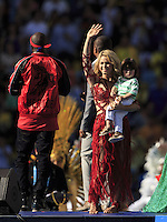 Shakira with her son Milan Pique performs during the closing ceremony