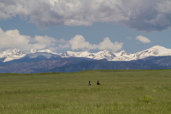 Horseback riders in meadow in Boulder, Colorado, Guided photo tours to Indian Peaks. .  John leads private photo tours in Boulder and throughout Colorado. Year-round.