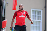 Wales football player Ashley Williams leaves the team bus as he arrives at training at the Vale Resort near Cardiff today.