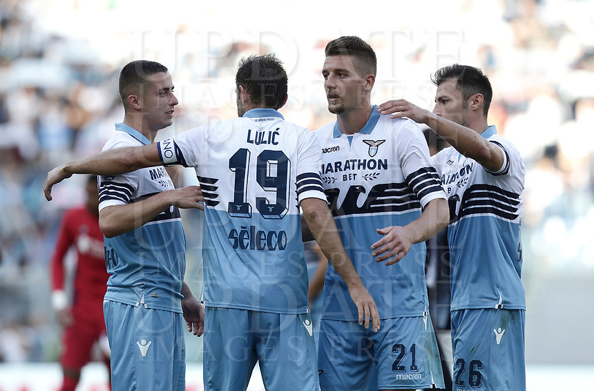 Football, Serie A: S.S. Lazio - Fiorentina, Olympic stadium, Rome, 7 ottobre 2018. <br /> Lazio's players celebrate after winning 1-0 the Italian Serie A football match between S.S. Lazio and Fiorentina at Rome's Olympic stadium, Rome on October 7, 2018.<br /> UPDATE IMAGES PRESS/Isabella Bonotto