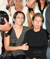 "Eloisa Vivas, right, mother of Venezuelan boxer Edwin IncaValero, champion of the World-wide Council of Box (CMB), during his  mourning by relatives and friends in Merida, Venezuela, April 21st 2010.Valero, famed for an impressive record of 27 straight knockouts and a huge tattoo of Chavez on his chest, hanged himself in his jail cell last week. The boxer, who was nicknamed ""El Inca"" in reference to an Indian warrior, committed suicide a day after he was arrested for murdering his 24-year-old wife."