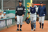 Staten Island Yankees pitcher Taylor Morton (6), catcher Isaias Tejeda (29) and coach Carlos Chantres (33) during game against the Brooklyn Cyclones at MCU Park on June 18, 2012 in Brooklyn, NY.  Brooklyn defeated Staten Island 2-0.  Tomasso DeRosa/Four Seam Images